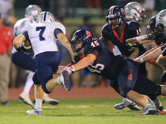 Belton-Honea Path's Austin Daniel goes for a tackle