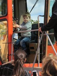 Jackson Twomey, 3, tries out a DPW truck.