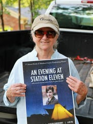 Amy Dietrich holds a poster promoting the 7th annual