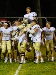 Sully Buttes freshman Landon Severson is carried off
