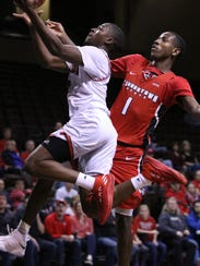 Triston Simpson of USD drives in for a layup against