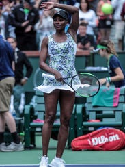 Venus Williams waves after defeating Sorana Cirstea,