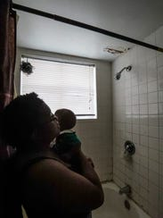 Diamond Robinson talks about her fear her bathroom ceiling will fall down from her upstairs neighbor's bathroom, a common problem for many tenants at Fort Myers' Jones Walker apartments.