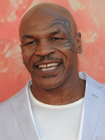 Former boxer Mike Tyson arrives on the red carpet for