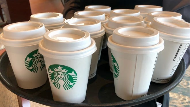 Small cups of Starbucks coffee were served after Starbucks Chairman Howard Schultz gave a speech at a Boys & Girls Club of Martin County luncheon.