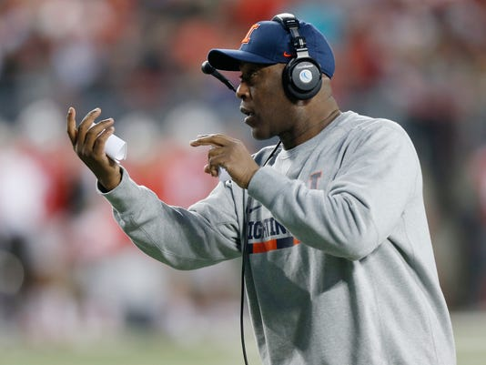 Illinois head coach Lovie Smith instructs his team against Ohio State during the first half of an NCAA college football game Saturday, Nov. 18, 2017, in Columbus, Ohio. (AP Photo/Jay LaPrete)