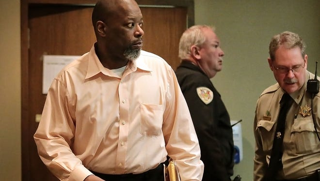 Ronald Ellis arrives in court for his murder trial in Judge James Beasley's court. He is charged with killing his former girlfriend Torhonda Cathey, 33, who was shot to death outside the Target on Colonial.