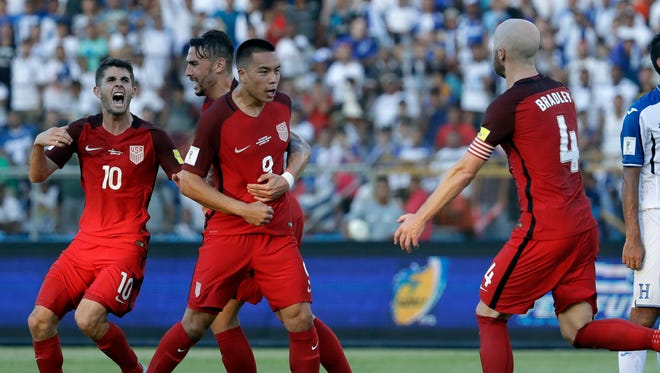 Bobby Wood celebrates his goal with USMNT teammates.