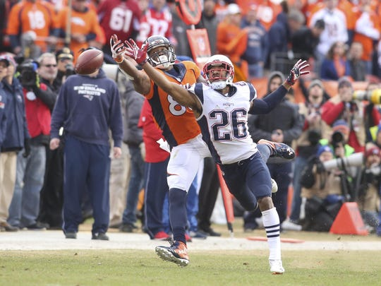 Jan 24, 2016; Denver, CO, USA; Denver Broncos wide receiver Demaryius Thomas (88) and New England Patriots cornerback Logan Ryan (26) struggle for a pass during the second half in the AFC Championship football game at Sports Authority Field at Mile High. Mandatory Credit: Chris Humphreys-USA TODAY Sports