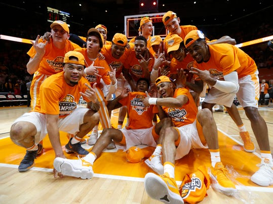 Tennessee players celebrate after defeating Georgia 66-61 in an NCAA college basketball game Saturday, March 3, 2018, in Knoxville, Tenn. (AP Photo/Crystal LoGiudice)