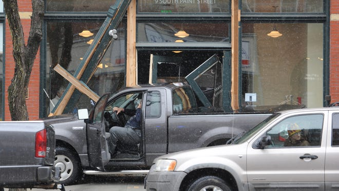 A truck crashed into the Carlisle building Thursday on South Paint Street. Two other vehicles were damaged in the crash.