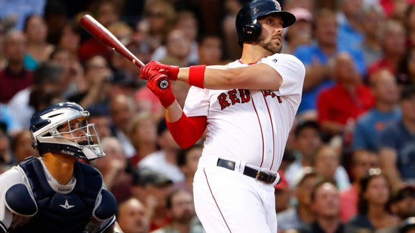 FILE - In this Aug. 9, 2016, file photo, Boston Red Sox's Travis Shaw watches a hit against the New York Yankees during the third inning of a baseball game at Fenway Park in Boston. The Boston Red Sox got the man they wanted _ a setup man, in fact. The AL East champions locked down their eighth-inning spot Tuesday, Dec. 6, 2016, acquiring right-hander Tyler Thornburg from the Milwaukee Brewers in a package that included infielder Travis Shaw .(AP Photo/Winslow Townson, File)