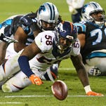Broncos linebacker Von Miller tries to recover a fumble after stripping the ball from Panthers QB Cam Newton in the fourth quarter during Super Bowl 50 at Levi's Stadium.