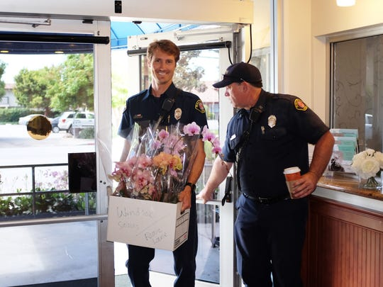 On Mother's Day, Salinas firefighters delivered many boxes of orchids to seniors in several locations. Here, personal delivery is being made to Windsor Gardens.