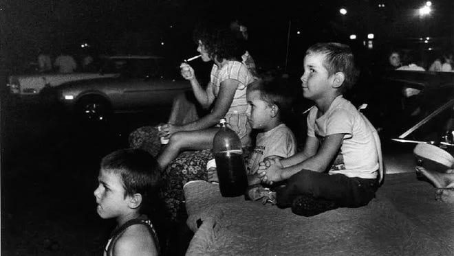 """The Valdez children take in a showing of """"E.T."""" at the Holiday Twin Drive-In in 1986."""