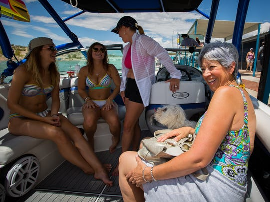 Mary Jo Martinez, right, has a laugh with others on a boat before casting off at Elephant Butte Lake State Park, July 2, 2016.