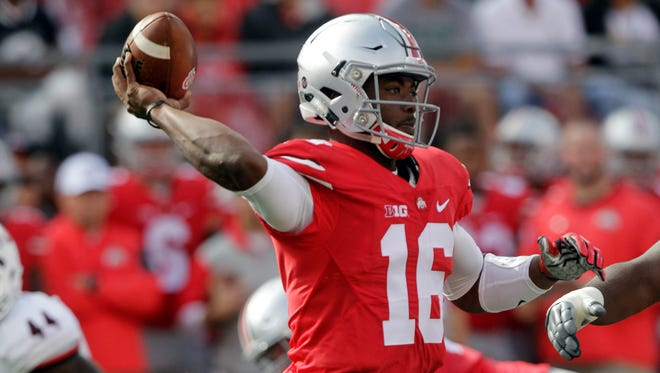 Ohio State quarterback J.T. Barrett throws a pass against Northern Illinois during the second quarter of an NCAA college football game Saturday, Sept. 19, 2015, in Columbus, Ohio. (AP Photo/Jay LaPrete)