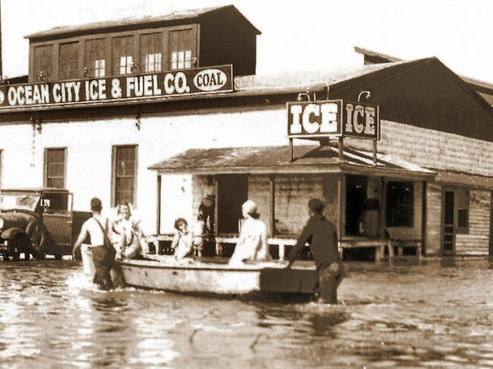 The day after the famous August Storm of 1933 hit the Eastern Shore, boats were needed to move residents and employees in Ocean City. The Ocean City Ice Plant, on Somerset Street and Philadelphia Avenue, had water flowing inside the building.