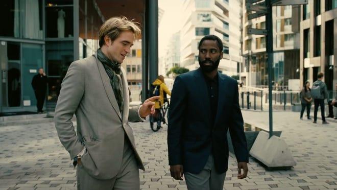"Robert Pattinson, left, and John David Washington work to prevent World War III in Christopher Nolan's ""Tenet."" The film's release has been postponed yet again, due to coronavirus conditions."