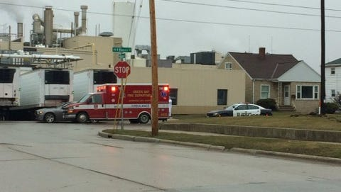 An ambulance leaves American Foods Group Monday morning.