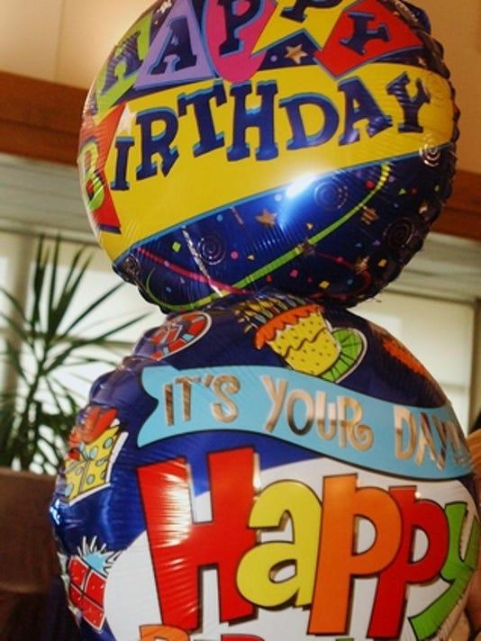 Happy-birthday balloons shown at Ester Carlson's birthday party.