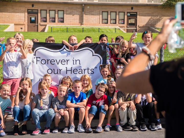 Students at Fiddlers Canyon Elementary gather around