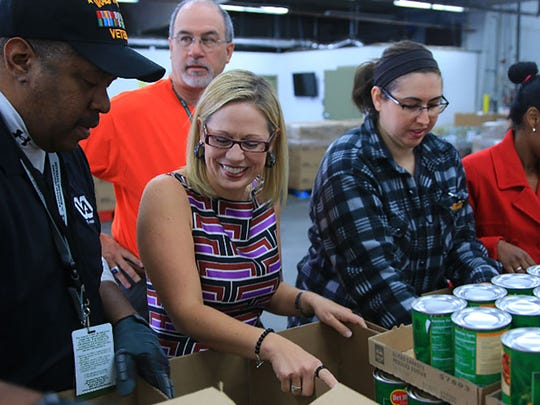 U.S. Rep. Kyrsten Sinema packs food boxes at United Food Bank in Mesa with the Wounded Warriors Project on Nov. 23, 2015.