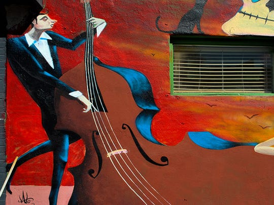 The image of a man playing an instrument adorns a wall in downtown Phoenix.