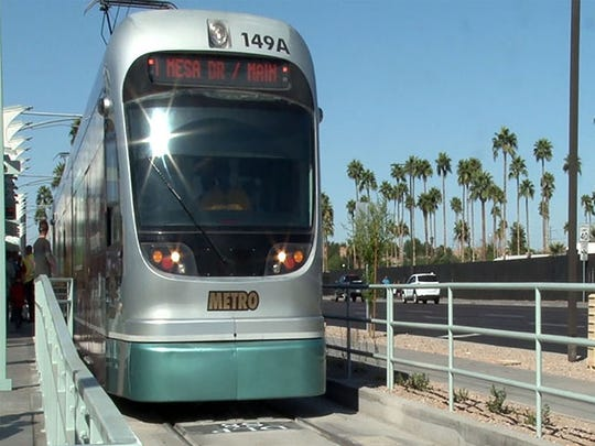 A train makes the inaugural run in March from Dunlap Station on an expanded leg of Valley Metro's light rail.