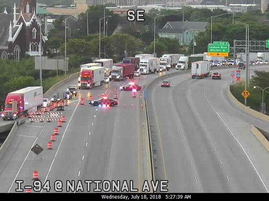 Motorists exit I-43/94 northbound at National Avenue. The northbound lanes were closed Wednesday morning because of a chemical truck crash.