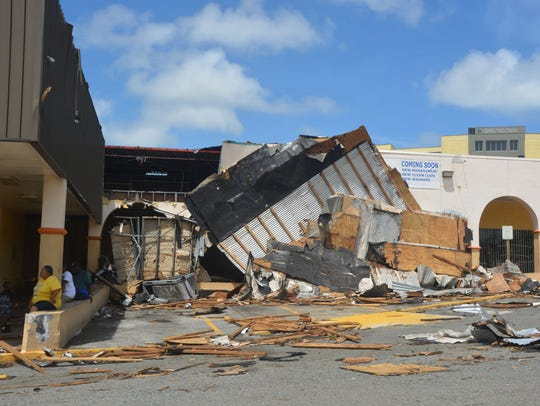 Residents seek shade near what was the laundromat at