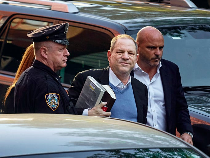 Harvey Weinstein arrives at the first precinct while