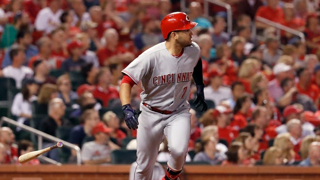 Cincinnati Reds' Eugenio Suarez watches his grand slam during the fifth inning of a baseball game against the St. Louis Cardinals on Wednesday, Sept. 13 in St. Louis.