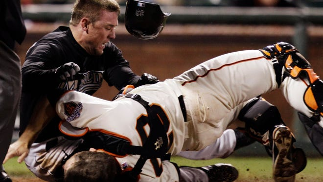Giants catcher Buster Posey, right, is bowled over by Scott Cousins of the Marlins in a May 2011 collision that knocked out Posey for the season.