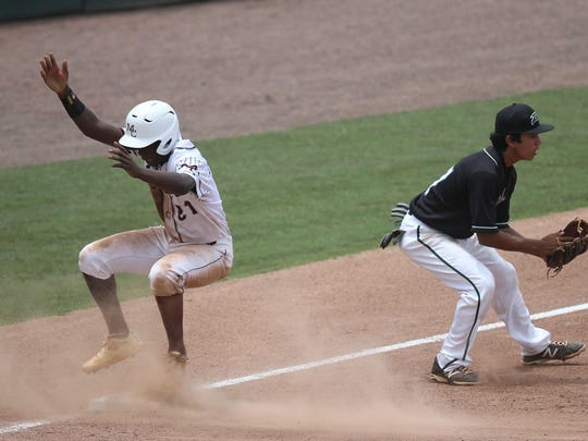 Madison County's Jae Mitchell steals third base against South Walton on Wednesday during an FHSAA Class 1A state semifinal at Hammond Stadium in Fort Myers.