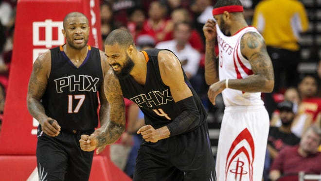 Phoenix Suns center Tyson Chandler (4) reacts after a play during the third quarter against the Houston Rockets.