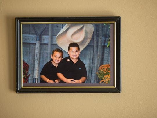 March 3, 2016: A photo of Jada Walkers sons Michaellii, now 5, and Jamarii, now 6, hangs on her wall. Walker has been off heroin since 2009, and says that methadone saved her.