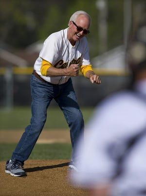 """DENNY SIMMONS / COURIER & PRESS Paul Gries celebrates his first pitch strike before the Central Bears took on the Mater Dei Wildcats at Central High School Thursday afternoon. The Bears were holding a ceremony naming their ballfield """"Paul Gries Field"""" after the longtime retired coach."""