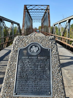 Times Record News-File Photo Ohio Street Bridge A marker tells the history of the old Ohio Street Bridge over the Wichita River. History buffs are trying to save and restore the century-old bridge, which has been closed to traffic/