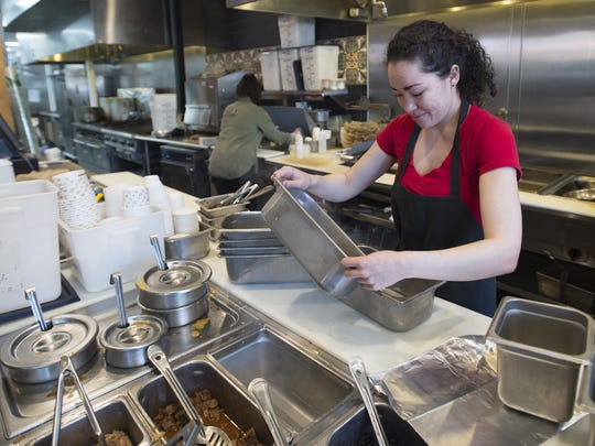 Sara de Noll works on the food line at Illegal Pete's in Old Town Fort Collins Thursday, April 6, 2017. The eatery is joining a group of restaurants labeling themselves as 'Sanctuary Restaurants.'