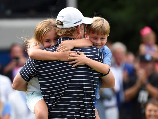 Brandt Snedeker is hugged by his children Lily (left)
