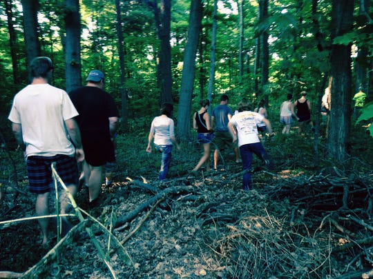 Put-In-Bay residents search a wooded area for Carter Pugh, 15, on Thursday, Aug 7, 2014.