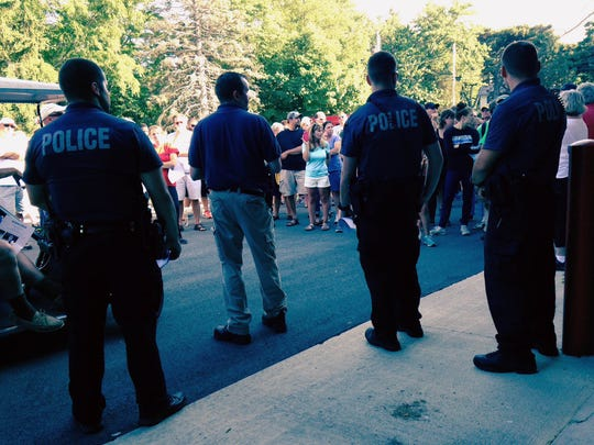 Residents for a search group as Put-In-Bay Police handout fliers as the search for Carter Pugh, 15, continues on Thursday, Aug 7, 2014.
