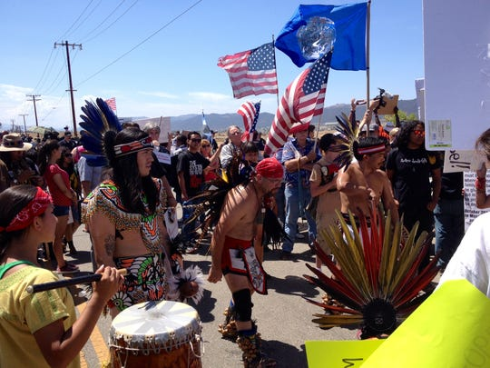 A group of Aztec dancers in traditional garb dance outside the Murrieta Border Patrol station on Friday, July 4, 2014.
