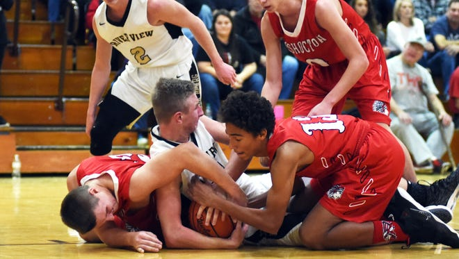 Coshocton's Logan Desender, left, and Tyren Walker try to steal the ball from River View's Chase Whitehair during the Black Bears' 48-36 win on Friday in an East Central Ohio League game at Luther Stover Gymnasium.