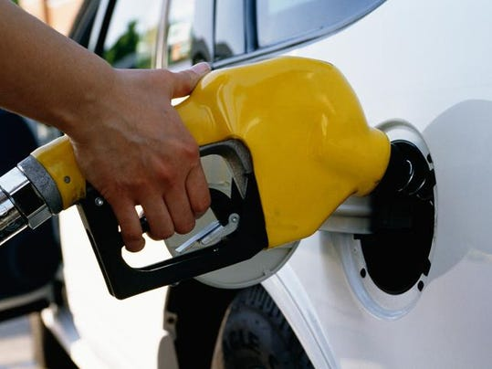 Person filling gas tank