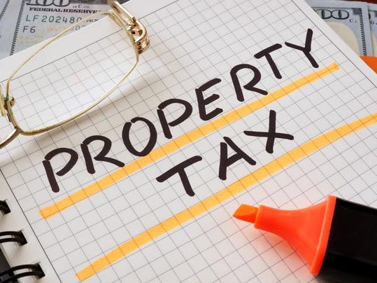 Notebook with property tax sign on a table.