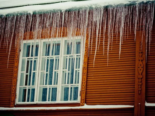 Snow, Icicles and Ice Dam on Roof and Gutter window