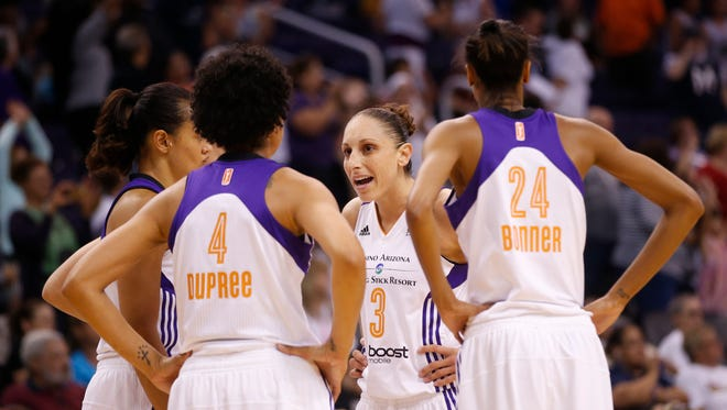 Phoenix Mercury guard Diana Taurasi talks with her teammates during a timeout with the Seattle Storm during the fourth quarter at US Airways Center on June 3, 2014, in Phoenix.