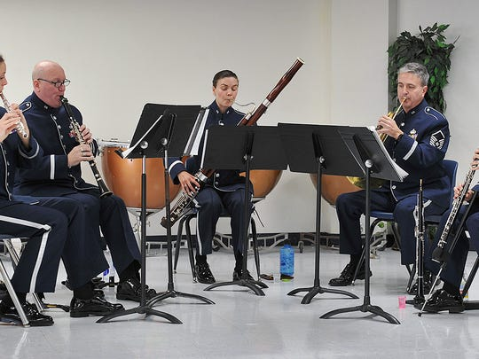 The Spectrum Winds ensemble of the Air Force Band of the West plays Christmas music Wednesday morning at Kirby Middle School.